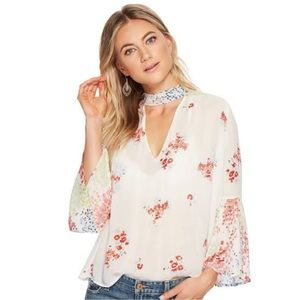 Lucky Brand floral bell sleeve tie neck blouse